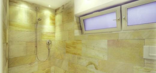 Wie im Schwimmbad wurde auch die Dusche mit Naturstein verfliest